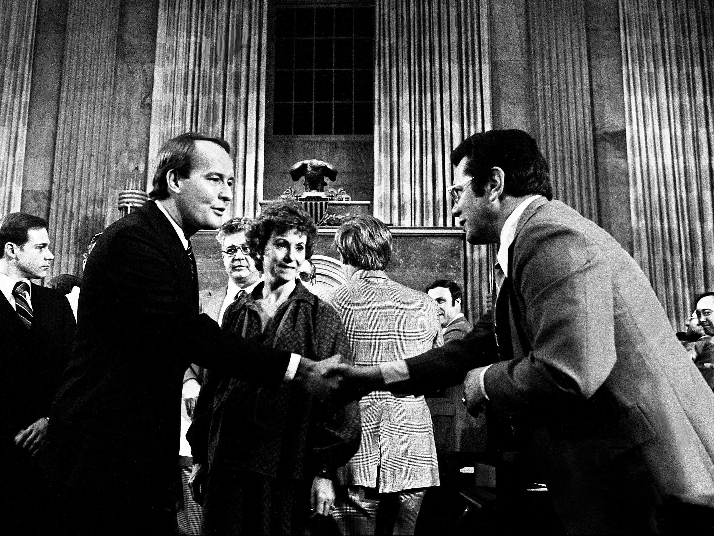 Gov. Lamar Alexander, left, with wife Honey, shakes hands with a legislator as he leaves the House chamber after his budget address to the joint legislature at the state Capitol on Feb. 28, 1979.