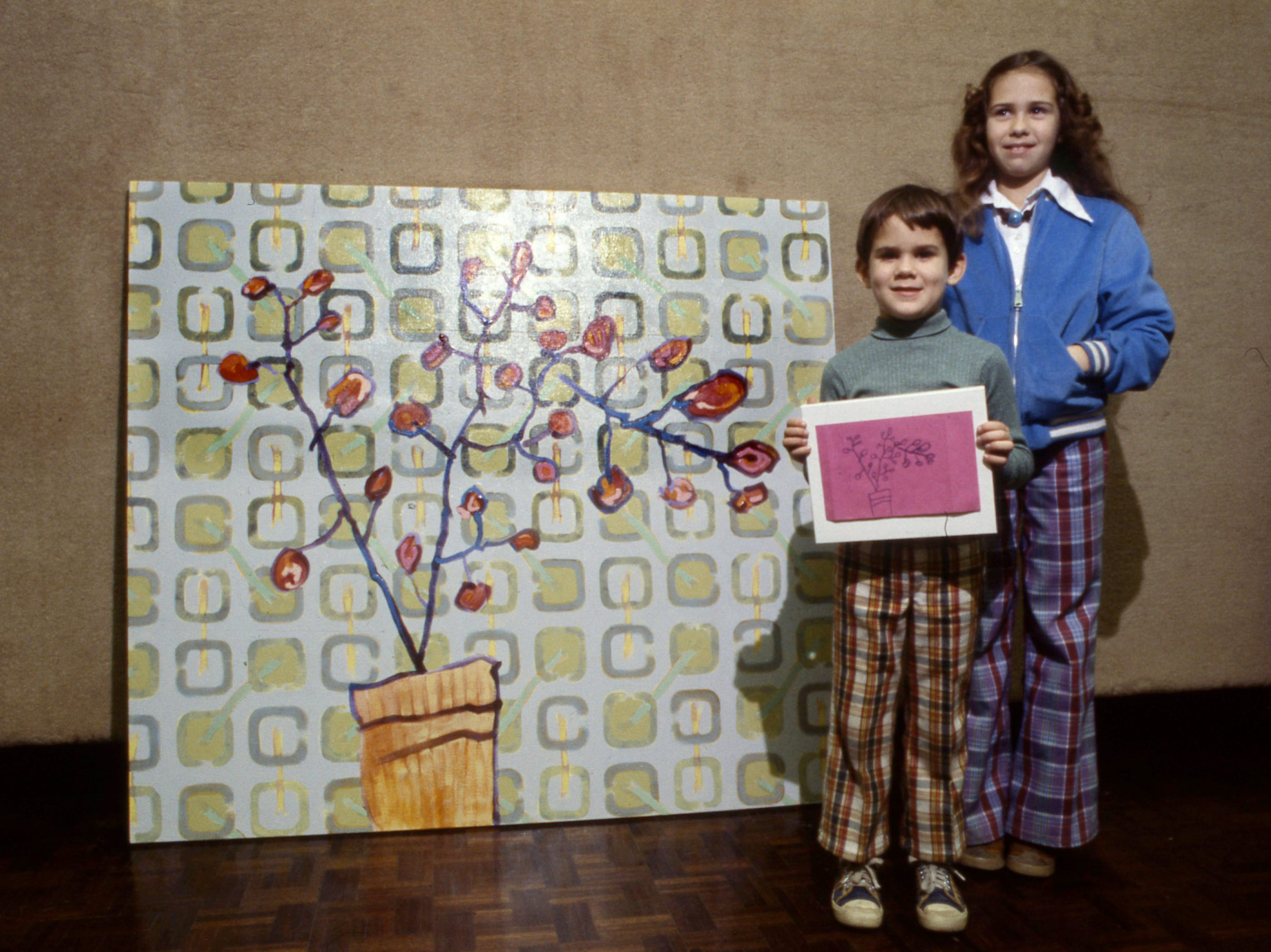 Bradley Hochstetler, 6, and sister Lynn, 11, collaborated on a Magic Marker drawing depicting the lemon tree that stands in the lobby of Austin Peay State University's Trahern Gallery. Their father, Max, reproduced it in his painting, elaborating the background and adding his own idea of colors.