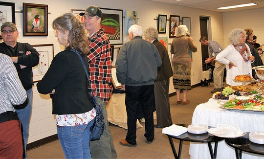 A reception was held on Saturday, Feb. 2, 2019, at the Fairview Public Library to open a month-long exhibit of artwork by local artisans and craftspeople.
