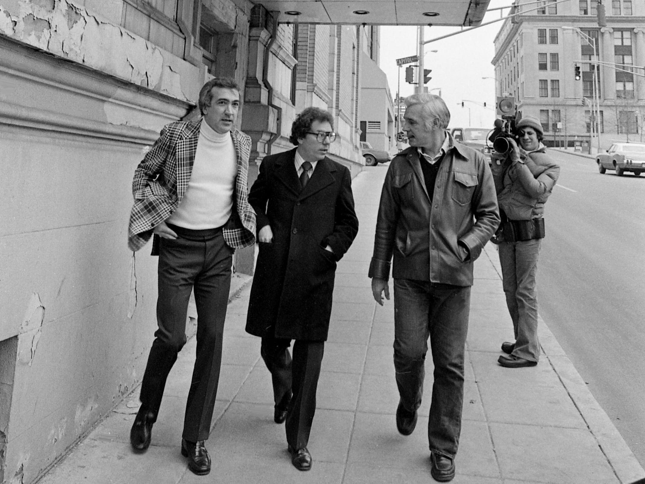 Metro Mayor Richard Fulton, front right, discusses the multimillion-dollar renovation plan for the once grand Hermitage Hotel with project coordinator Lloyd Buzzi, left, and leasing agent Jerry Carroll outside the hotel Feb. 17, 1979. The plan of Topeka businessman B.B. Anderson would transform the 69-year-old structure, which has been closed since 1977 after city codes violations.