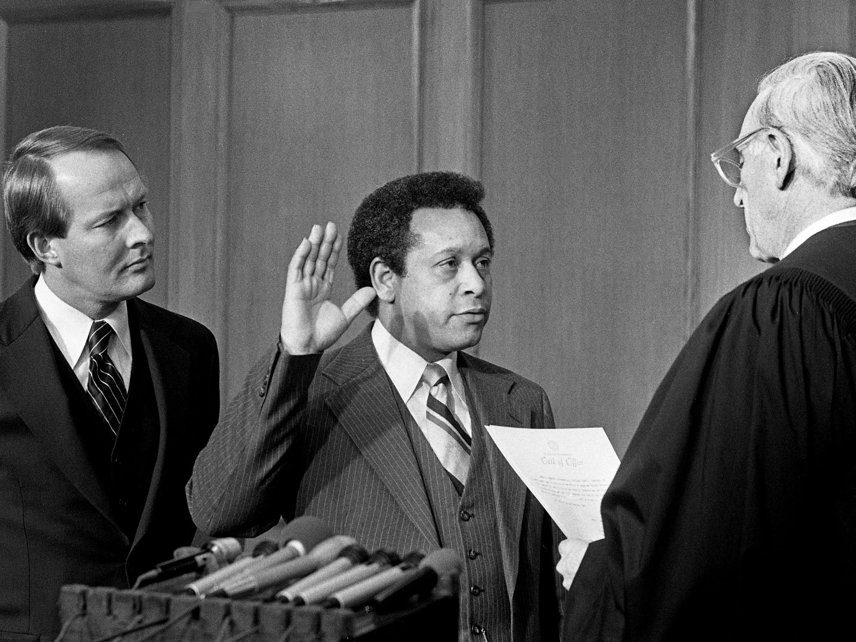 Metro Councilman Jimmy Hawkins, center, is sworn in as director of the state Office of Urban and Federal Affairs by Judge Henry F. Todd, right, as new Gov. Lamar Alexander looks on at the state Capitol on Feb. 7, 1979.