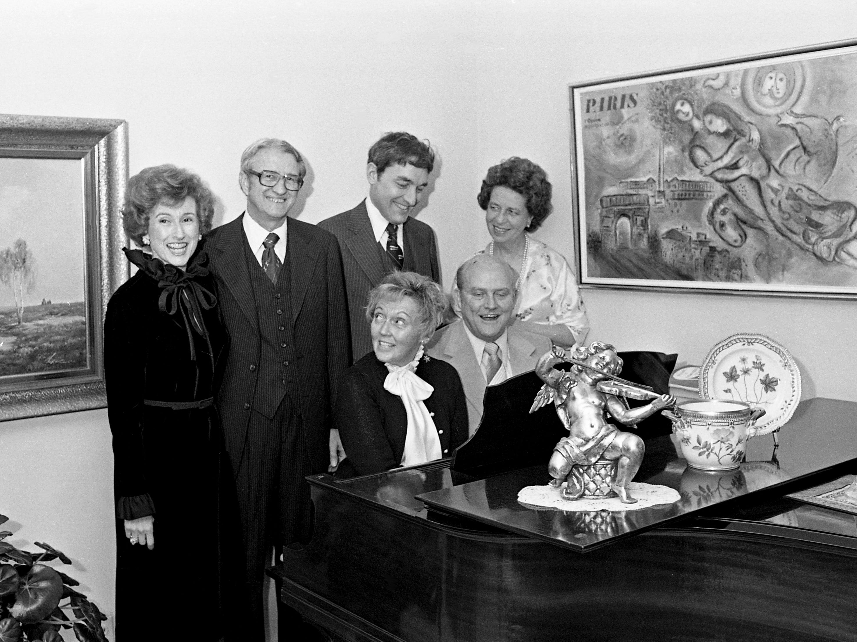 Mrs. and Dr. Stanley Bernard, standing left, entertain guests at a cocktail dinner Feb. 25, 1979, at their home in honor of the chairmen of the upcoming Heart Gala at the Opryland Hotel. Enjoying a song fest around the piano with the hosts are Tom Watts, president of the benefit, Mrs. Walter Robinson Jr., Miss Dorothy Primm, seated left, and Bob Joyner.