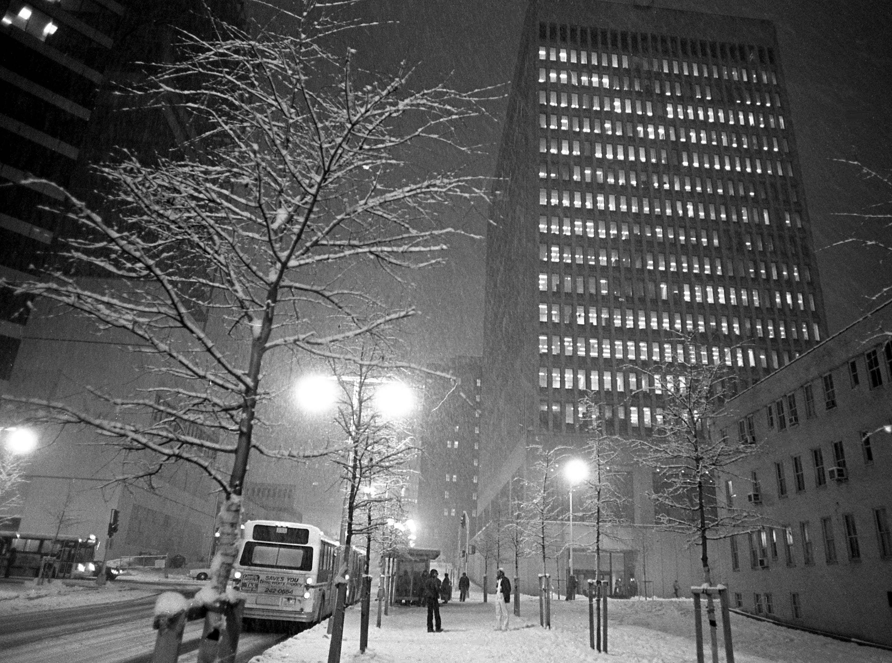 Snow falls during light traffic on Charlotte Avenue at night in downtown Nashville on Feb. 8, 1979.