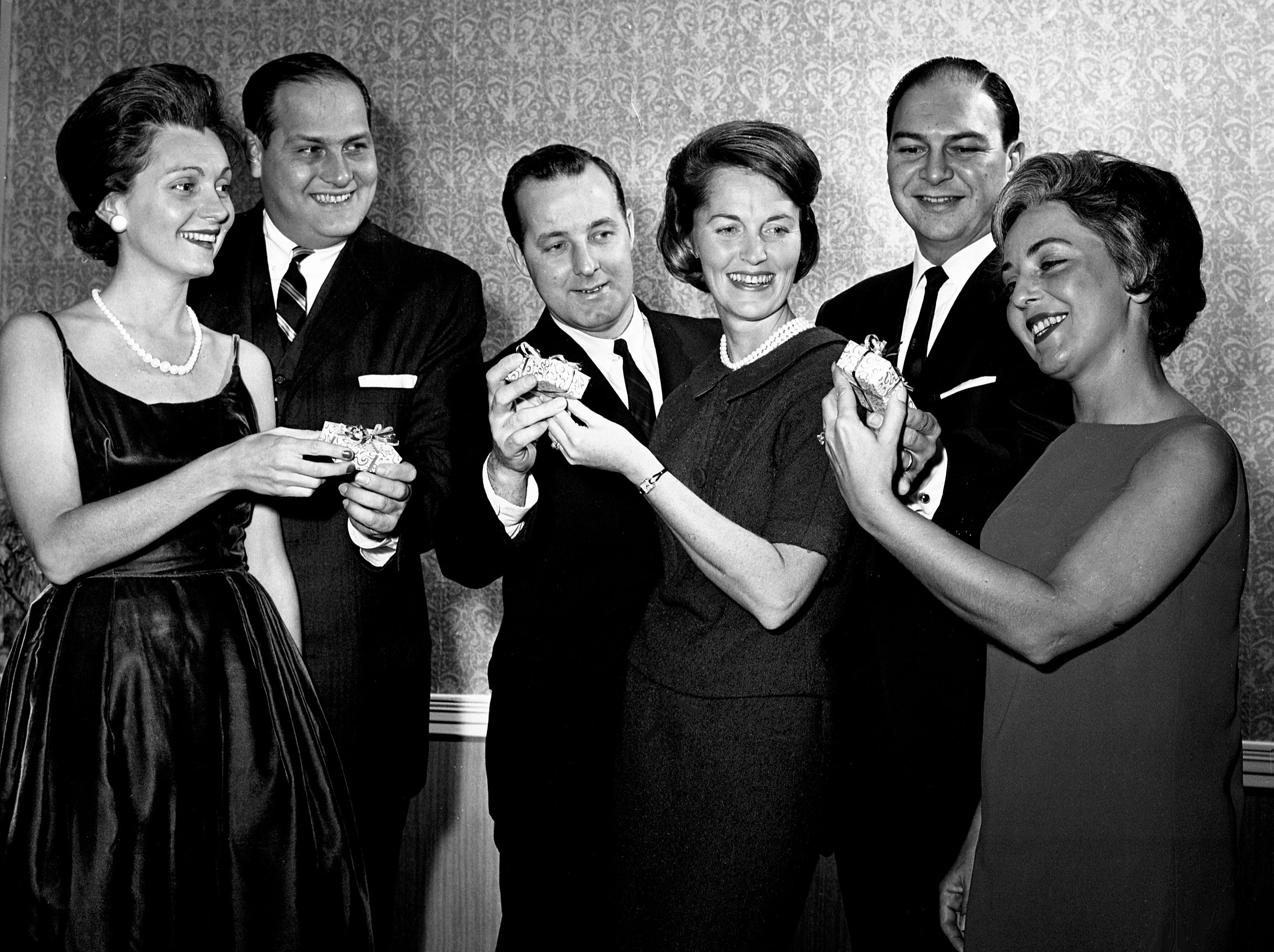 Richland Country Club is the scene of the Lions Club annual Valentine Party on Feb. 13, 1964. Favors are being presented to all the ladies at the party, which includes Mrs. and Mr. James Bennett, left, Mr. and Mrs. Charles A. Daugherty and Mr. and Mrs. Norman Lipman.