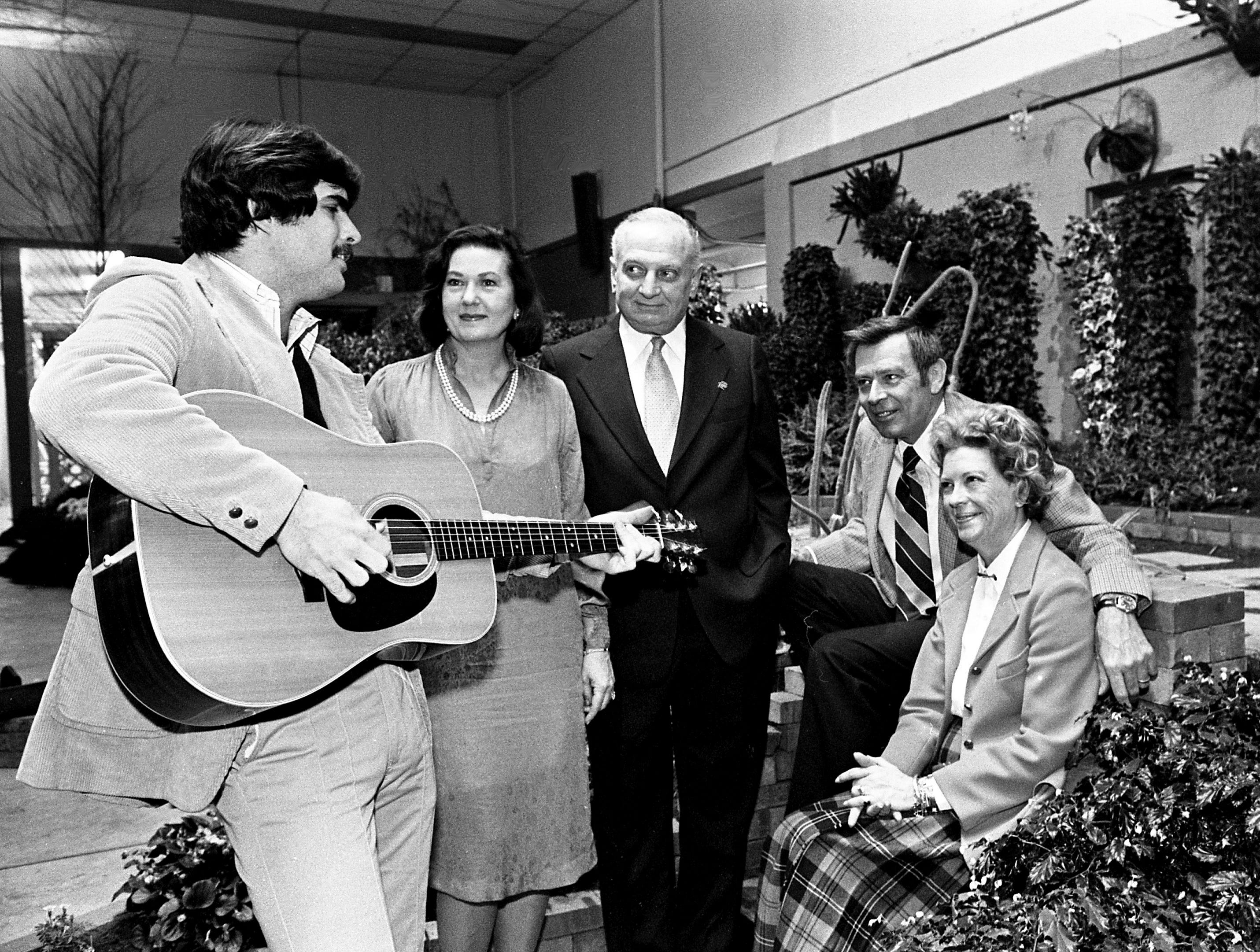 Songwriter Terry Lewis, left, entertains Mrs. and Mr. William Weston and Mr. and Mrs. Billy T. Sumner during the Lawn and Garden Preview Party on Feb. 7, 1979, at the state fairgrounds.