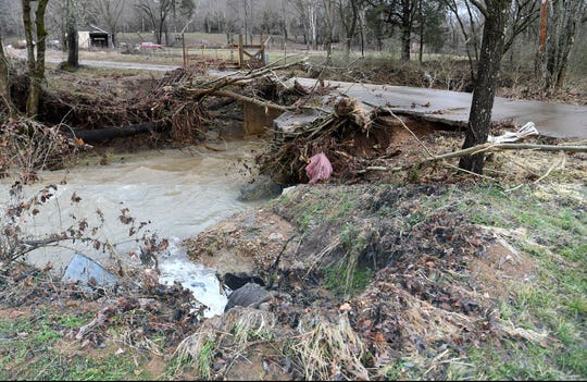 Damage from rushing water is visible along Pond Creek Road in Cheatham County after overnight flooding Thursday, Feb. 7, 2019.