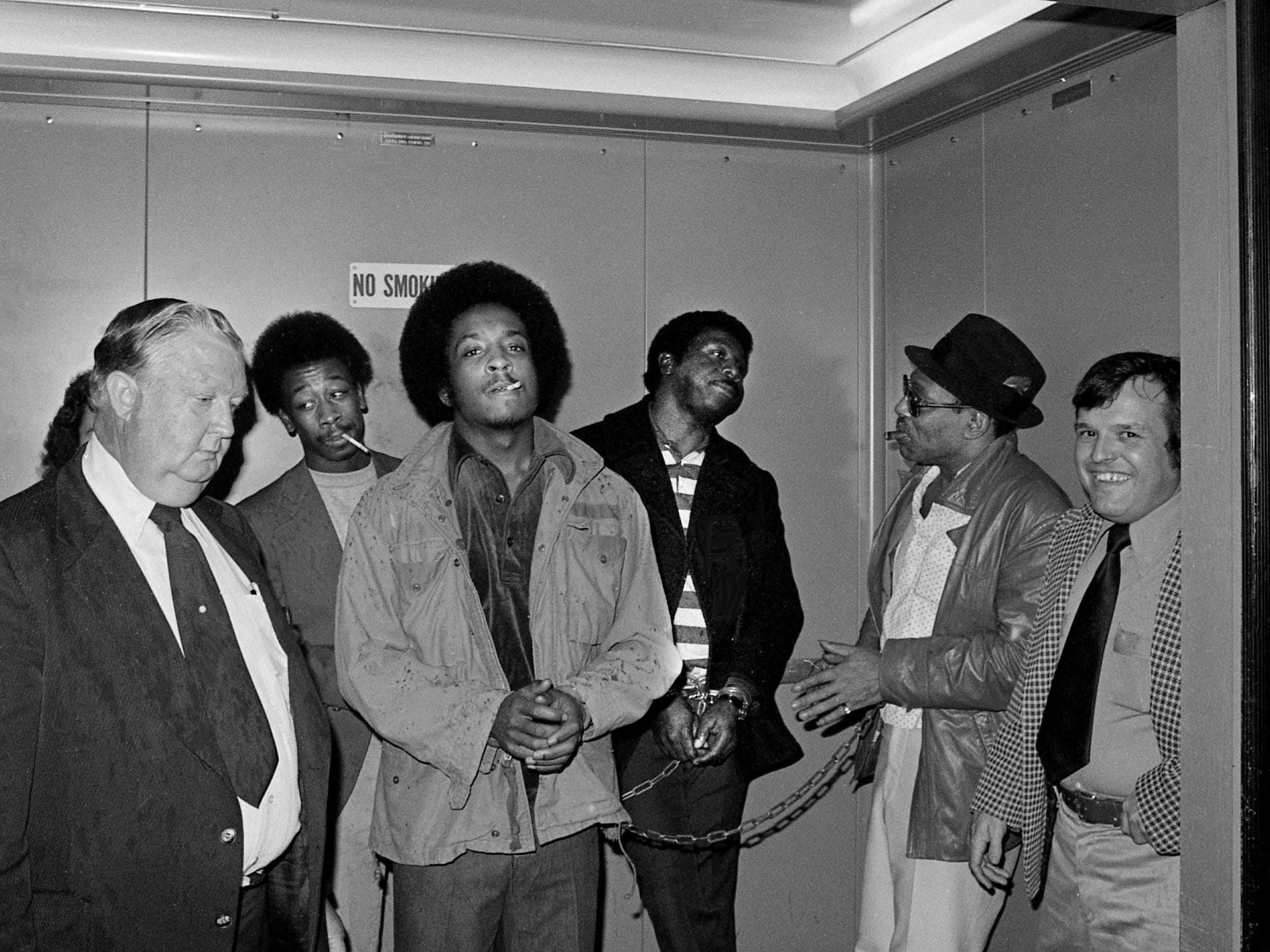 U.S. Marshal Charles Throgmorton, left, Correctional Rehabilitation Center inmates Roland Harris, Calvin Brown, John Henry Gant and Ike Franklin and U.S. Marshal Larry Cravens board an elevator in the federal courthouse Feb. 23, 1979. The inmates were testifying before the grand jury investigating the pardons and parole practice of former Gov. Ray Blanton's administration.