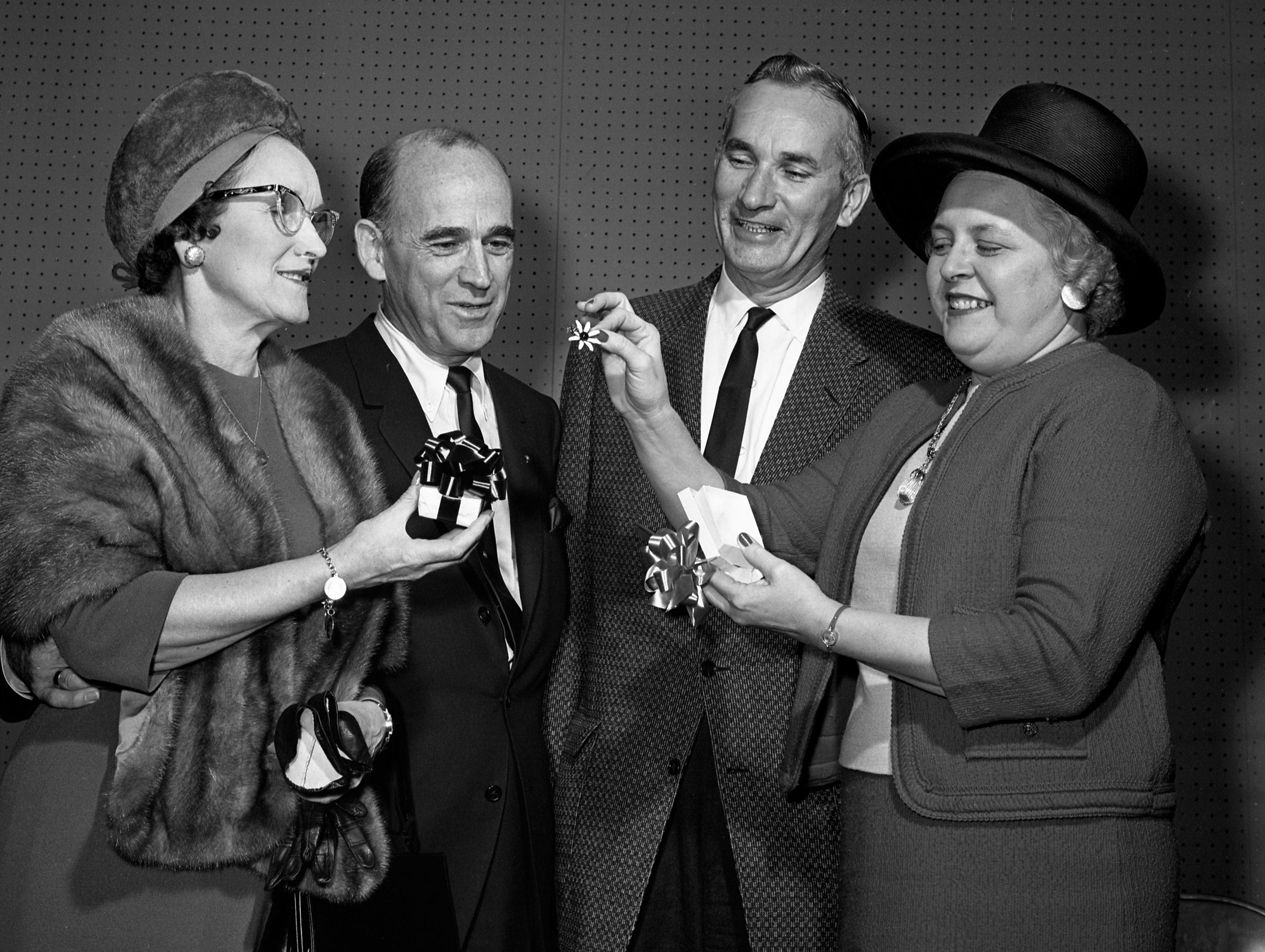 Members of the Downtown Lion's Club are entertaining at a Valentine party at the Top of the Plaza at Belle Meade Plaza honoring their wives Feb. 11, 1965. Admiring favors presented the ladies are Mrs. and Mr. Fred Waller and Mr. and Mrs. Wade Foster.