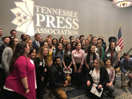 Tennessee Gov. Bill Lee poses with college students after speaking to the Tennessee Press Association in Nashville on Feb. 7, 2018.