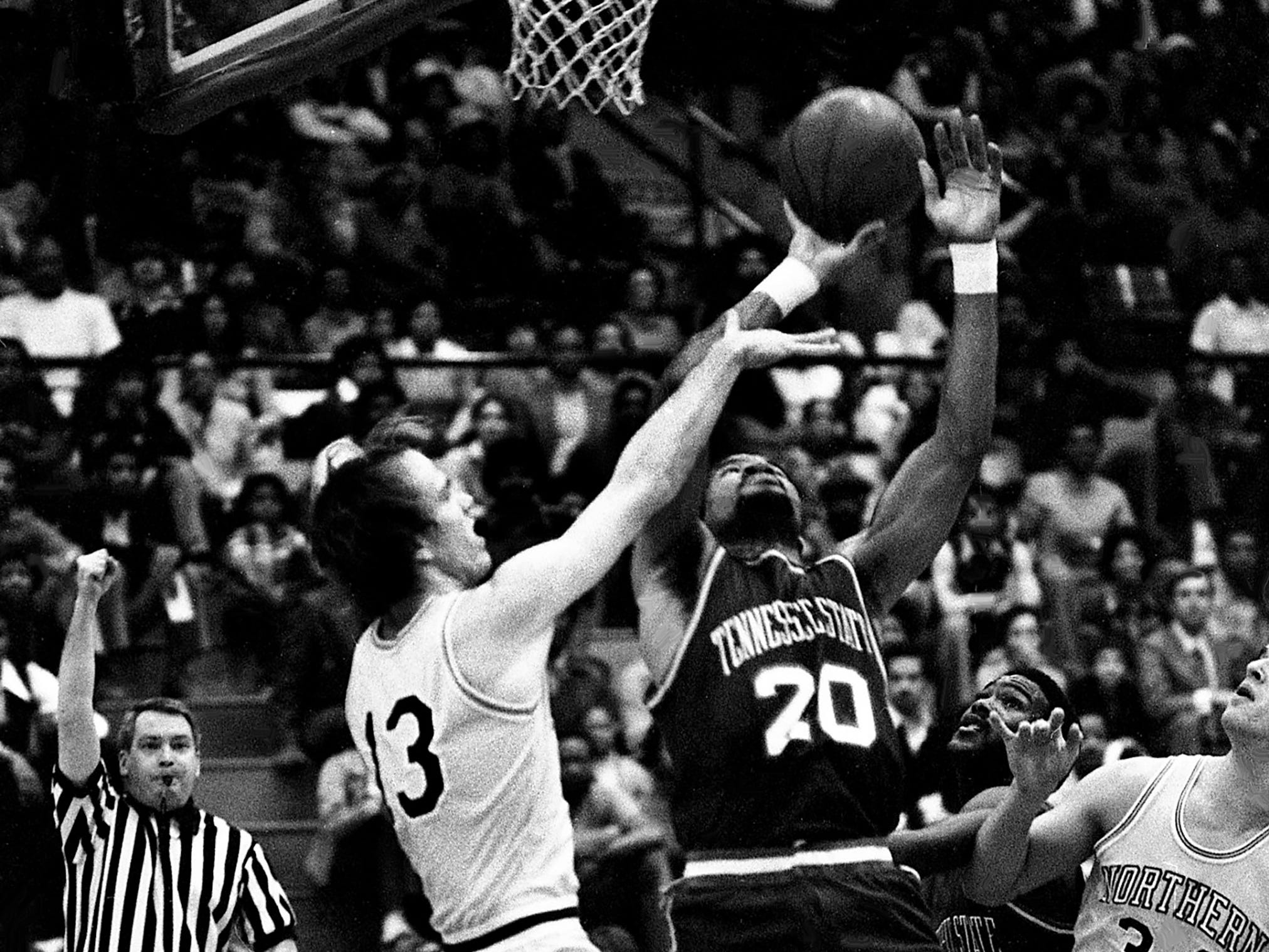 Tennessee State's Billy Tucker (20) takes a shot inside despite the double team of Northern Kentucky defenders at Kean's Little Garden on Feb. 3, 1979. Tucker scored 11 points in Tennessee State's 84-73 victory.