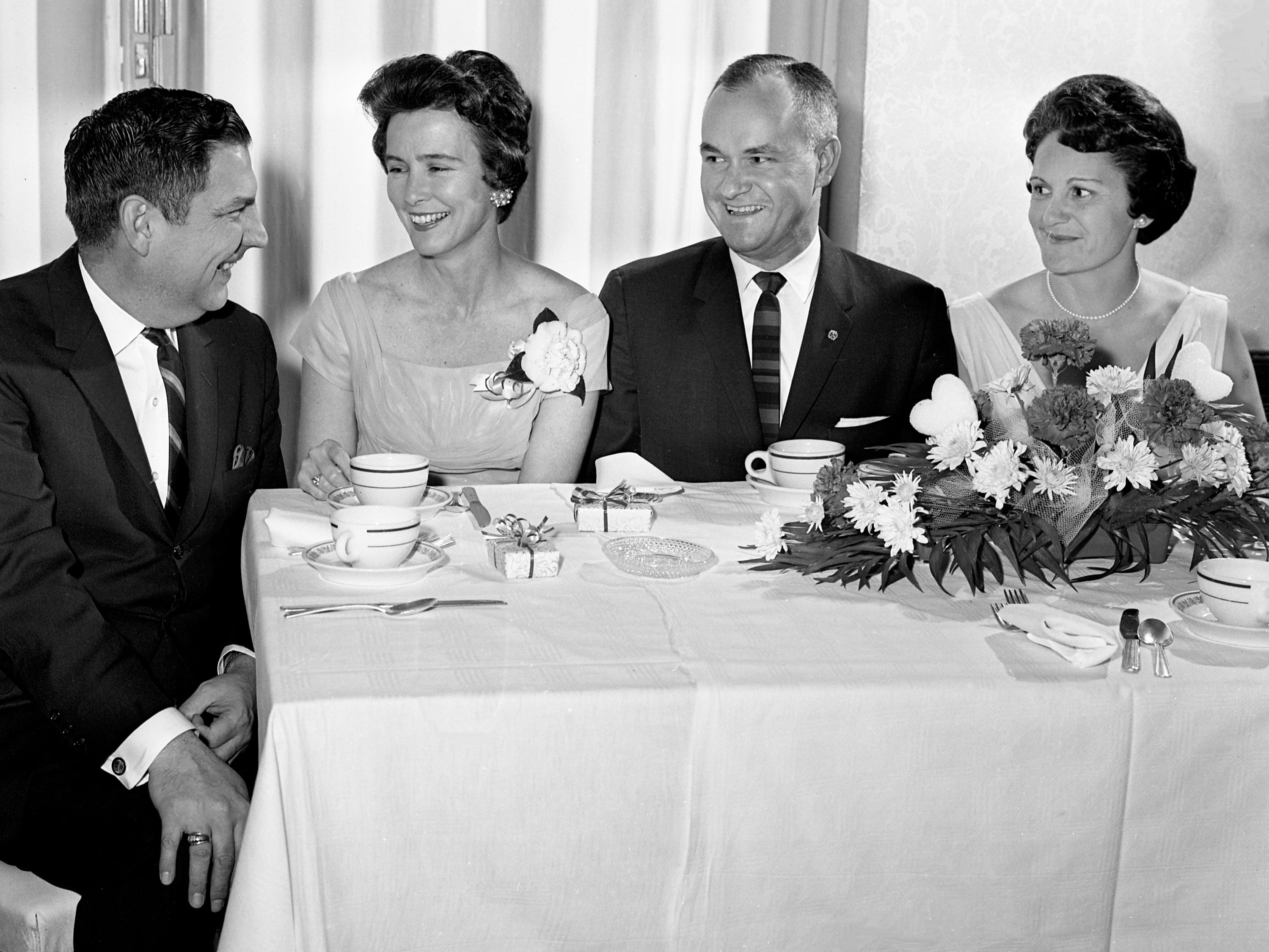 Richland Country Club is the scene of the Lions Club annual Valentine Party on Feb. 13, 1964. Dining together are Mr. and Mrs. Gayle Gupton, left, and Mr. and Mrs. Daniel M. Van Sant.