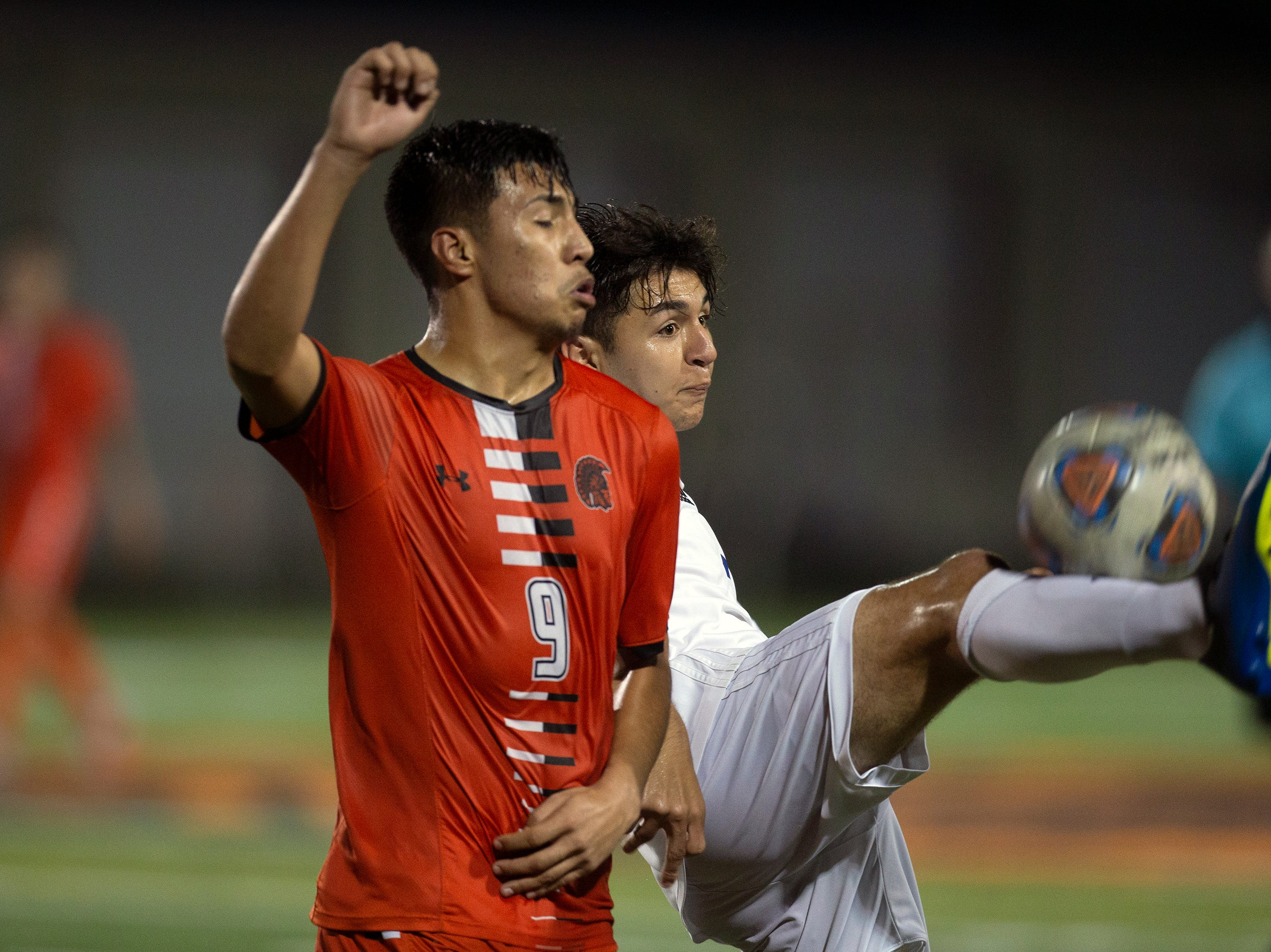 Cape Coral Ethan Wiese kicks the ball away from Lely's David Gomez, Wednesday, Feb. 6, 2019, at Lely High School.