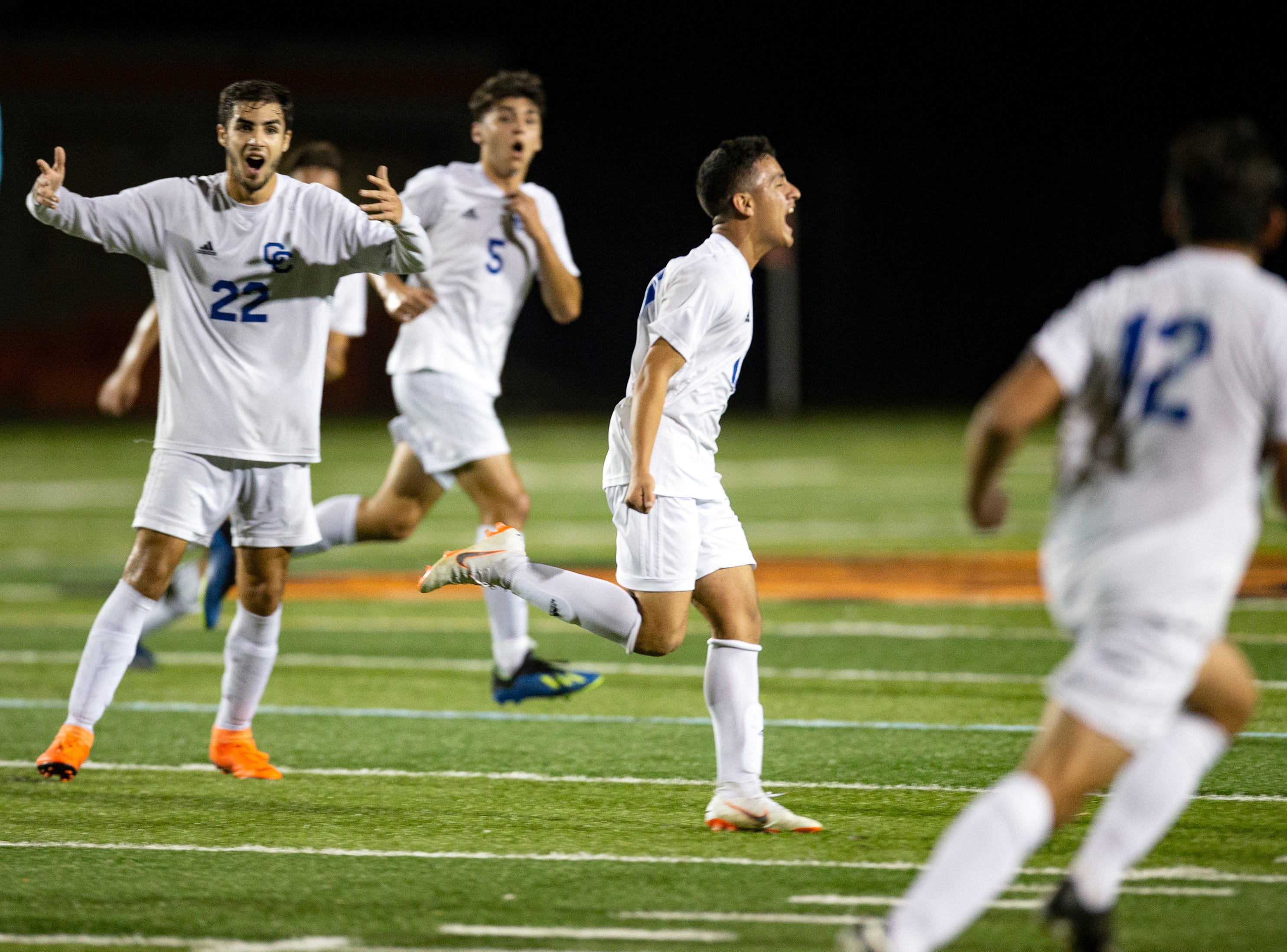 Cape Coral's Danilo Gomez, second from right, celebrates after scoring a goal against Lely High School, Wednesday, Feb. 6, 2019, at Lely High School.