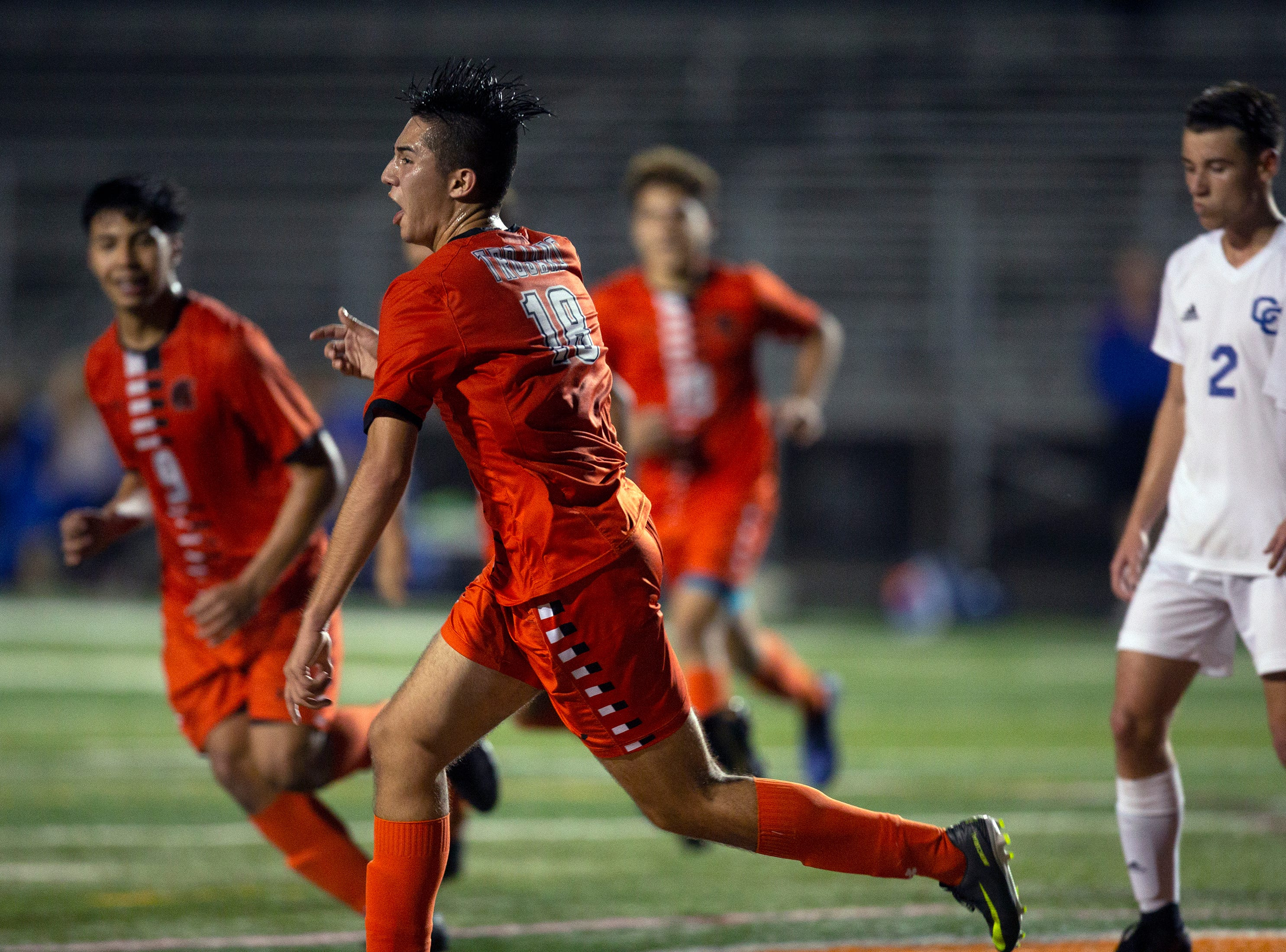 Lely High School's Jesus Barrera celebrates after scoring a goal against Cape Coral, Wednesday, Feb. 6, 2019, at Lely High School.