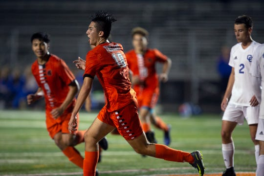Lely High School's Jesus Barrera celebrates after scoring a goal against Cape Coral in regionals this season. Beginning next season, Lely will share a district will four other Collier County teams in its winter sports.