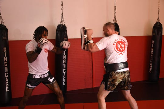 Alexandre, left, works out with Evolution Mixed Martial Arts' owner Keith Rummel. Evolution's new Muay Thai/ Kickboxing head coach Cosmo Alexandre is a seven-time World Champion and still actively fighting in three different combat sports professionally (Muay Thai, Kickboxing, MMA).