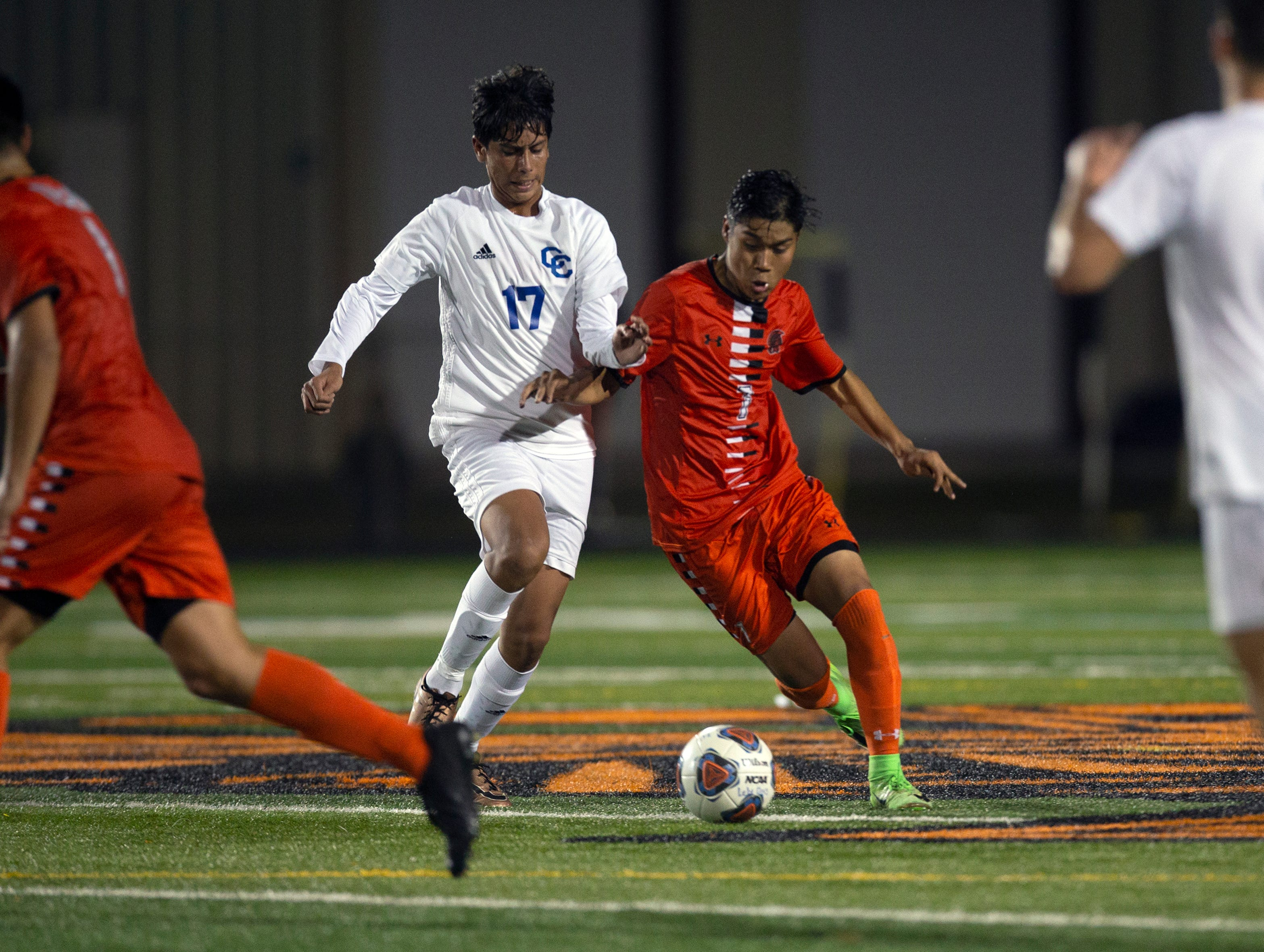 Cape Coral Adreil Gomez and Lely's Alan Garcia chase down the ball during their game, Wednesday, Feb. 6, 2019, at Lely High School.