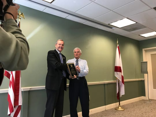 Collier County Sheriff Kevin Rambosk, left, and retiring Naples Daily News editorial page editor Allen Bartlett. Community leaders praised Bartlett for his 43-year career in journalism as a reporter, city editor and editorial page editor.
