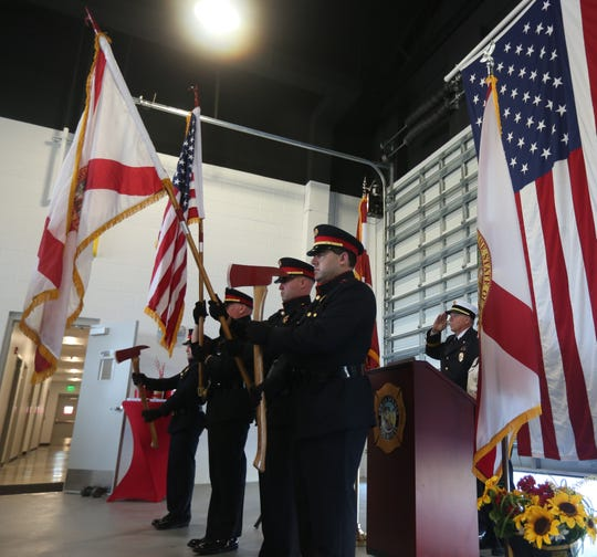 The Bonita Springs Fire Guard post the colors for the Pledge of Allegiance at Fire Station 23 grand opening Thursday.