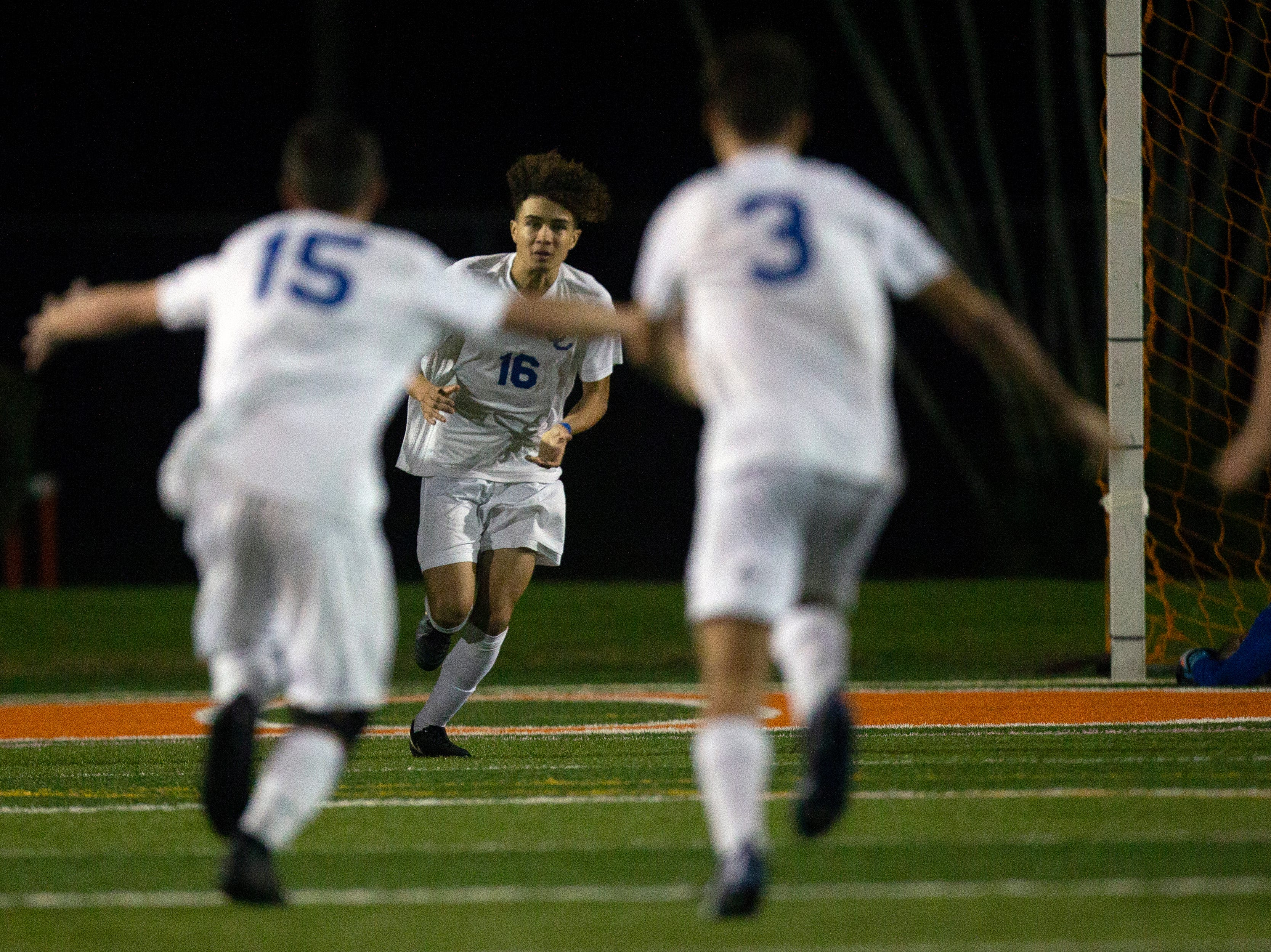 Cape Coral's Joao Soares runs back to his teammates after kicking in the winning goal during a penalty kick, Wednesday, Feb. 6, 2019, at Lely High School.