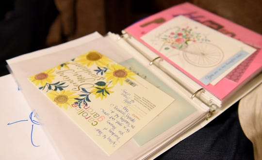 Get Well cards to nin-year-old Sydney Gunton  from friends and family organized in a binder. Sydney was found to have a brain aneurysm in January of 2019.