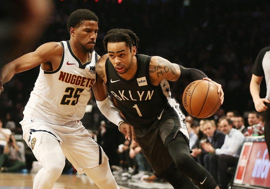 Feb 6, 2019; Brooklyn, NY, USA; Brooklyn Nets guard D'Angelo Russell (1) dribbles against Denver Nuggets guard Malik Beasley (25) during the second half at Barclays Center.