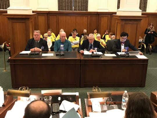 Opponents of medically assisted suicide testify at a hearing in the Statehouse on Feb. 7, 2019.