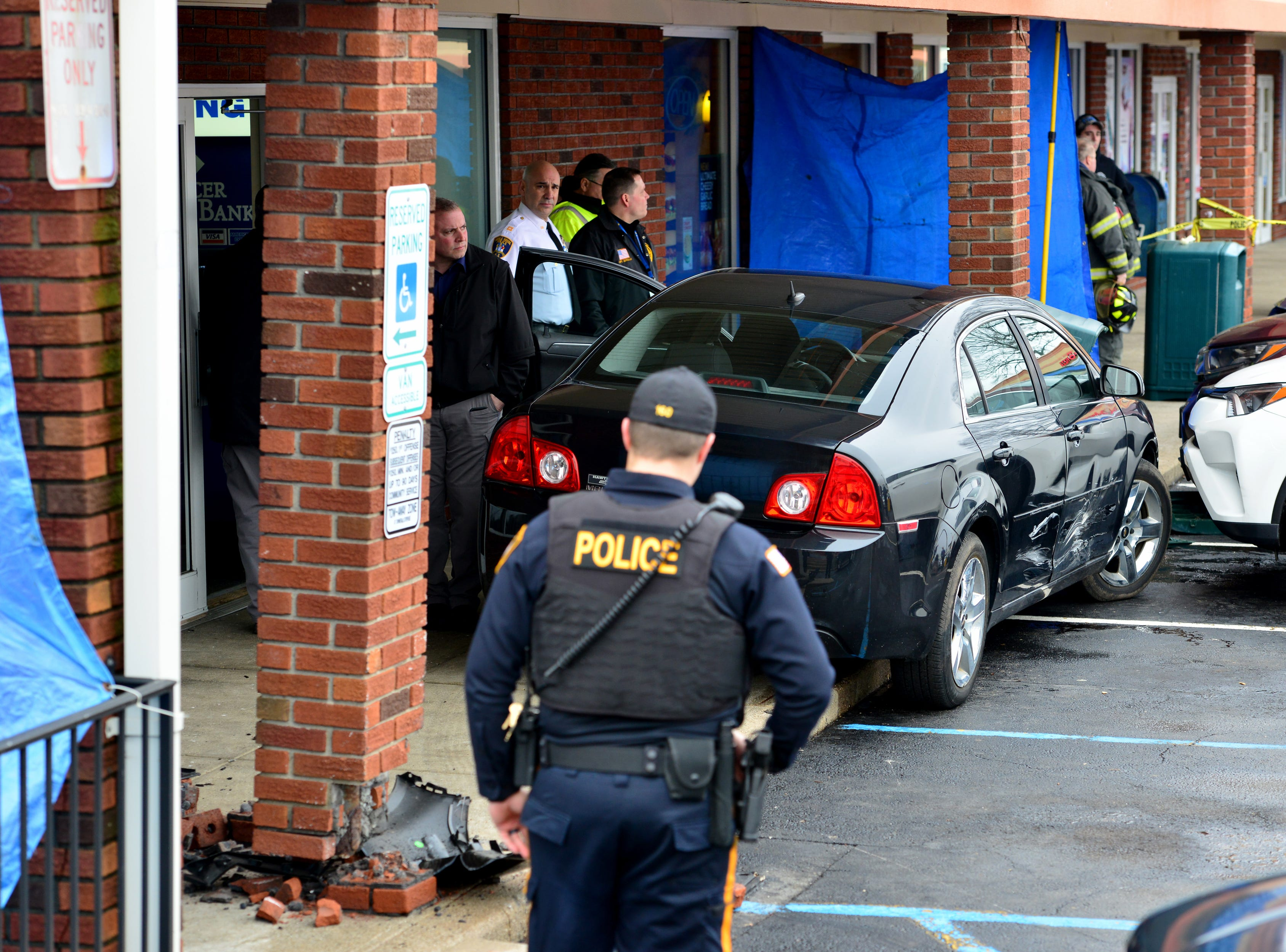 A car struck a building in a shopping center on Market St in Saddle Brook on Thursday February 7, 2019.