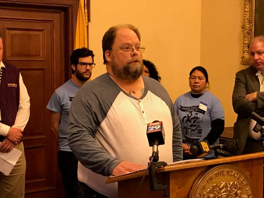 "Bruce Miller, 56, received eight weeks of severance after losing his job at a Sears Auto Center in Toms River after more than 35 years of service. ""It wasn't nearly enough,"" he said at a news conference in the Statehouse on Feb. 7, 2019."