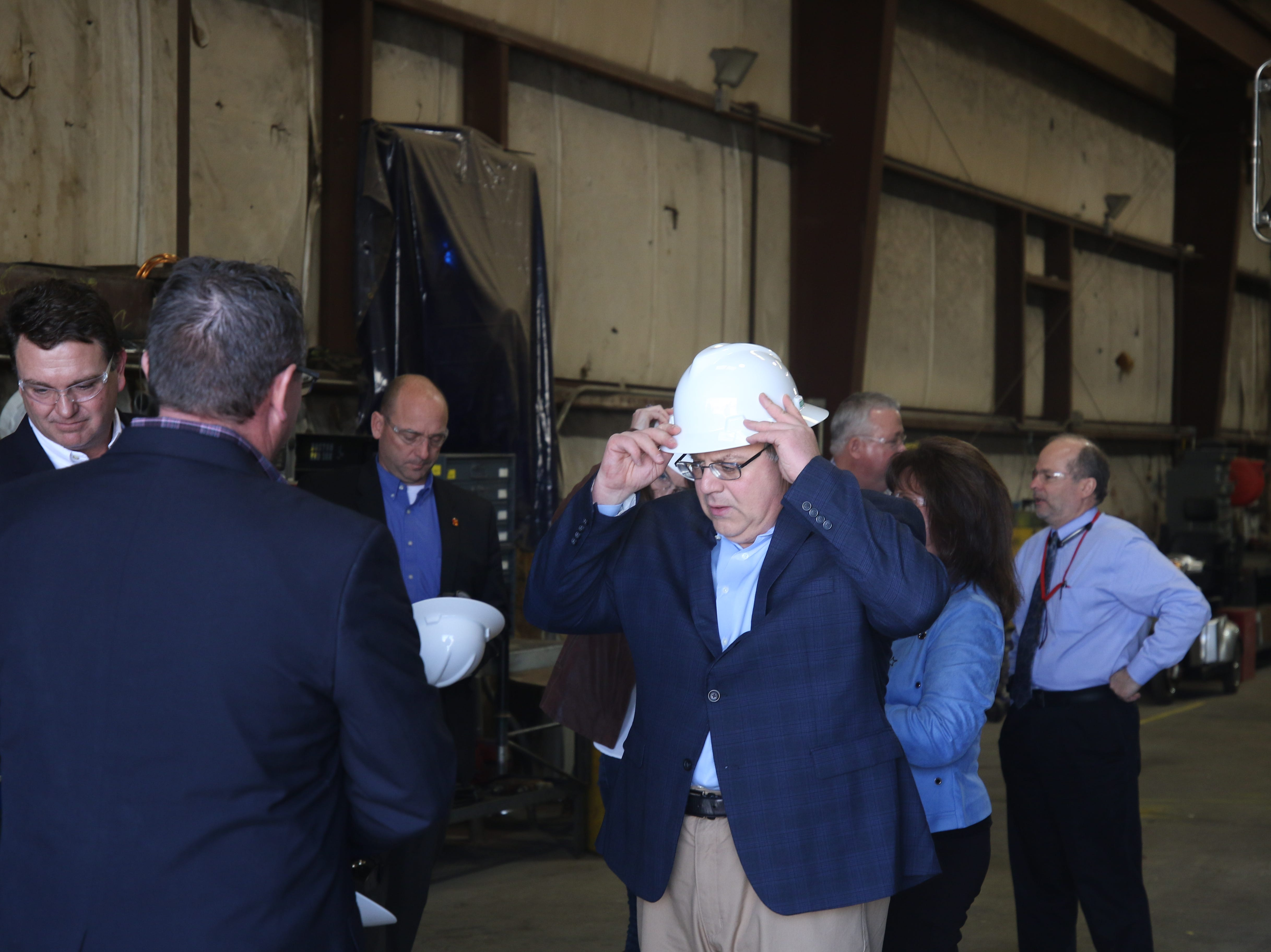 Acting U.S. Secretary of the Interior David Bernhardt puts on a hard hat before a tour of Watson Hopper, Feb. 6, 2019 in Hobbs.