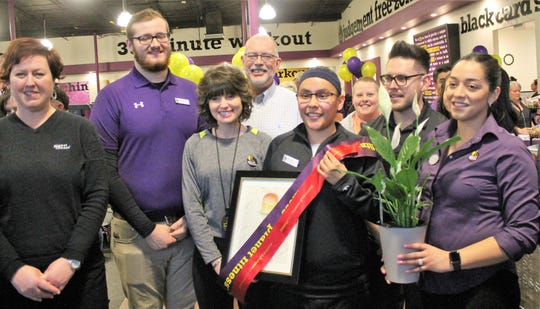 Planet Fitness Manager Nicole Lesansee and Planet Fitness staff at the Planet Fitness on 10th Street's grand opening celebration Wednesday evening.