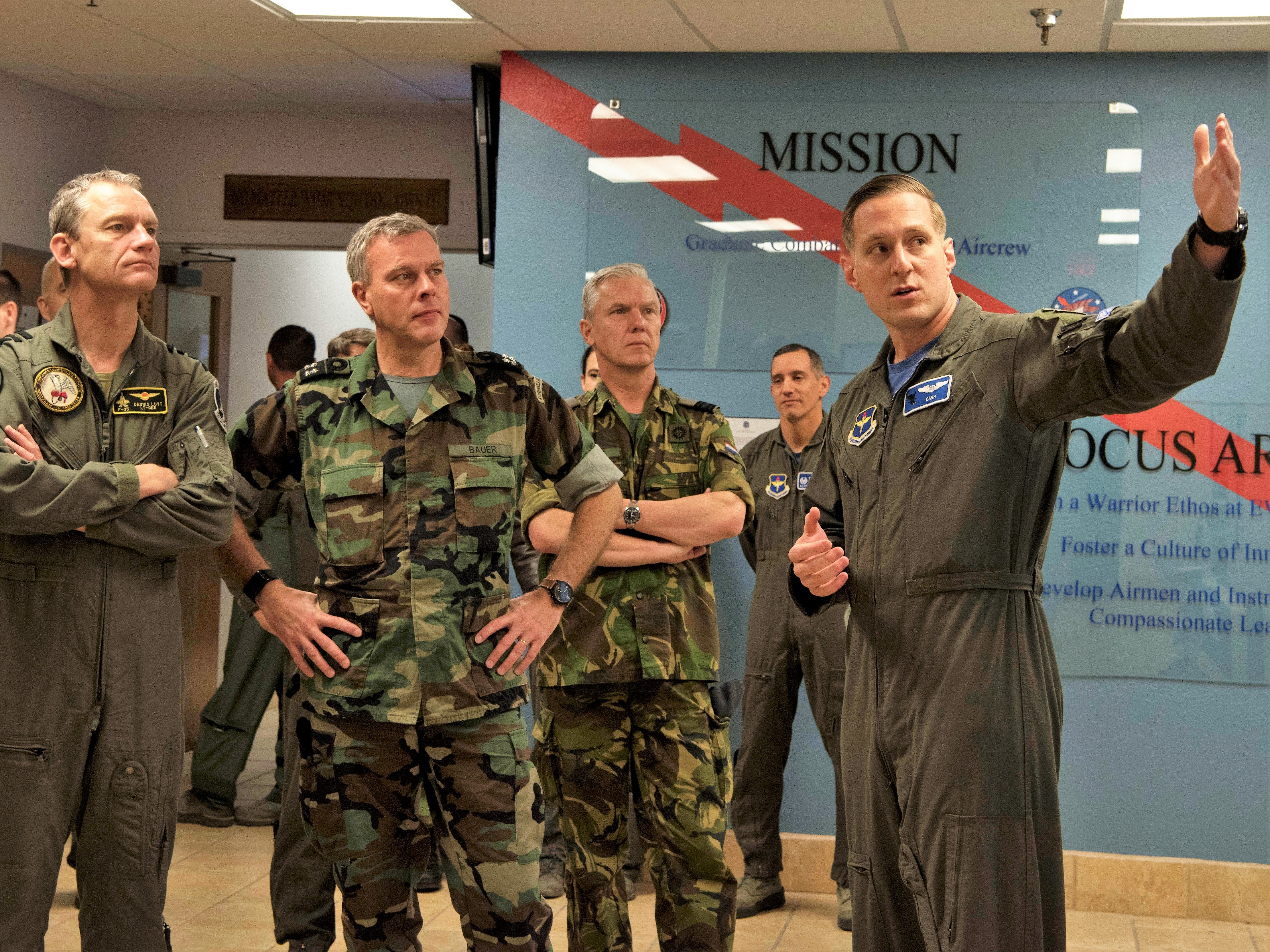 Capt. David Asche, 6th Attack Squadron flight commander, shows live feed televisions to Admiral Rob Bauer, Netherlands Chief of Defense and Lt. Gen. Dennis Luyt, Royal Netherlands Air Force commander, Feb. 1, 2019, in the 6th Attack Squadron on Holloman Air Force Base, N.M. Netherlands defense and military officials visited Holloman to tour the facilities where their MQ-9 Reaper pilots and sensor operators are being trained.