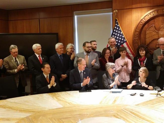 "Governor Michelle Lujan Grisham signs the ""rocket docket"" Monday."