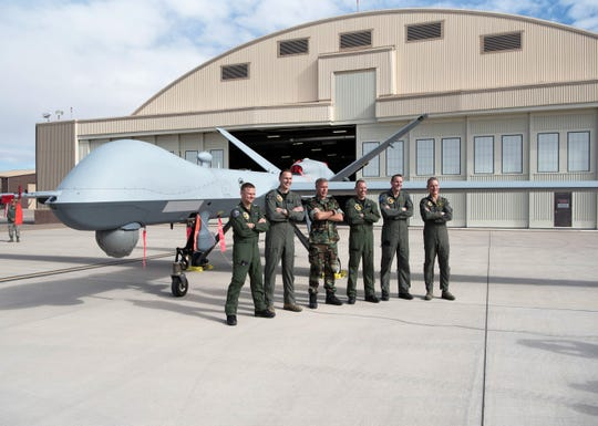 Netherlands defense and military officials pose in front of an MQ-9 Reaper remotely piloted aircraft static display, Feb. 1, 2019, on the flightline on Holloman Air Force Base, N.M. Netherlands defense and military officials visited Holloman to tour the facilities where their MQ-9 Reaper pilots and sensor operators are being trained.