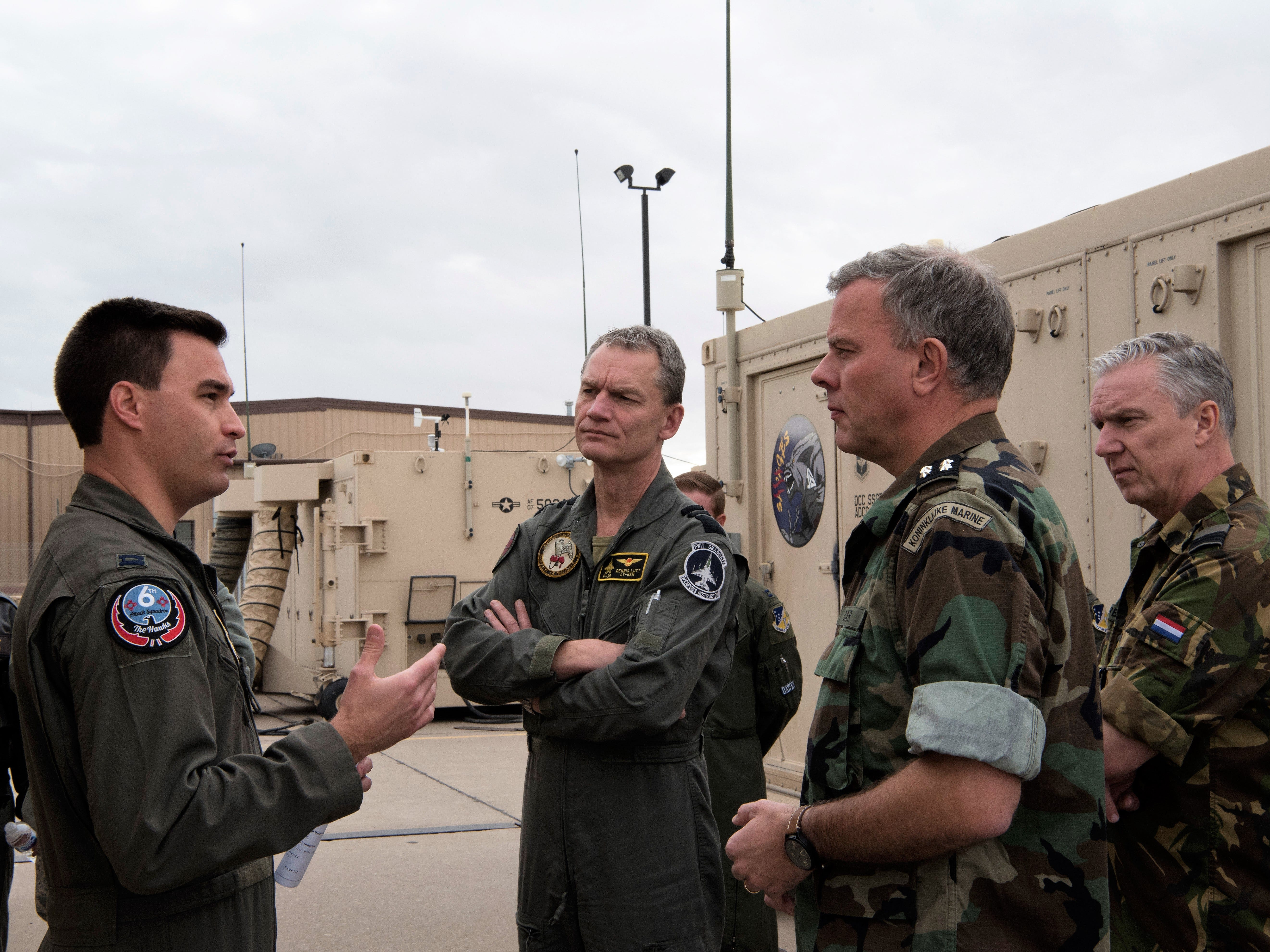 Capt. Trevor Miller, 6th Attack Squadron flight commander, describes a block 30 cockpit to foreign defense and military, Feb. 1, 2019, on Holloman Air Force Base, N.M. Netherlands defense and military officials visited Holloman to tour the facilities where their MQ-9 Reaper pilots and sensor operators are being trained.