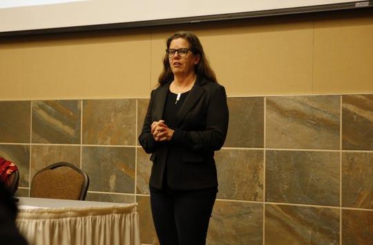 Public Lands Solutions Managing Director Ashley Korenblat presents information about outdoor recreation Thursday at Farmington Civic Center.