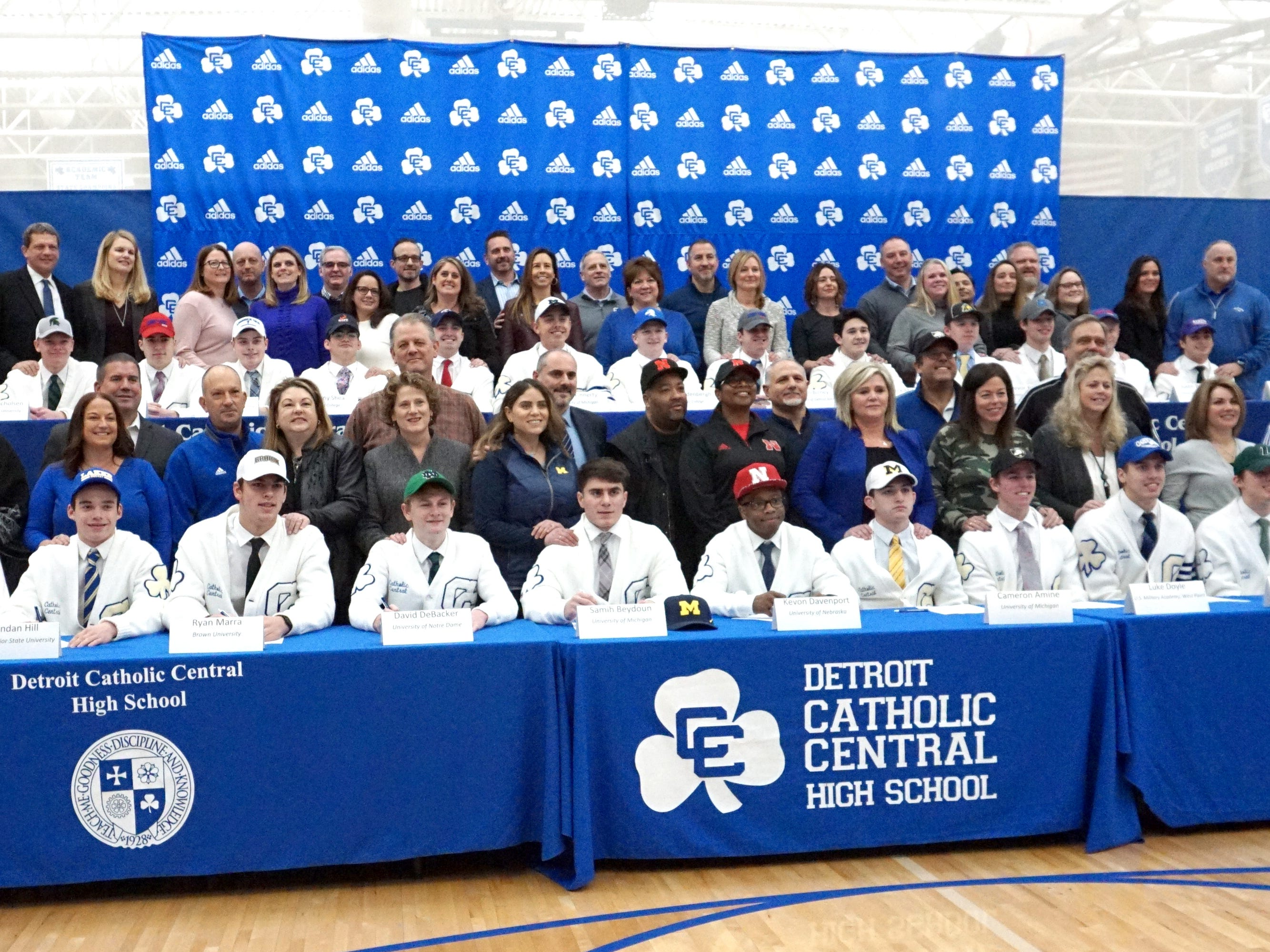 Detroit Catholic Central's 25 scholar-athletes pose with their families on Feb. 7 during the school's Signing Day ceremony.