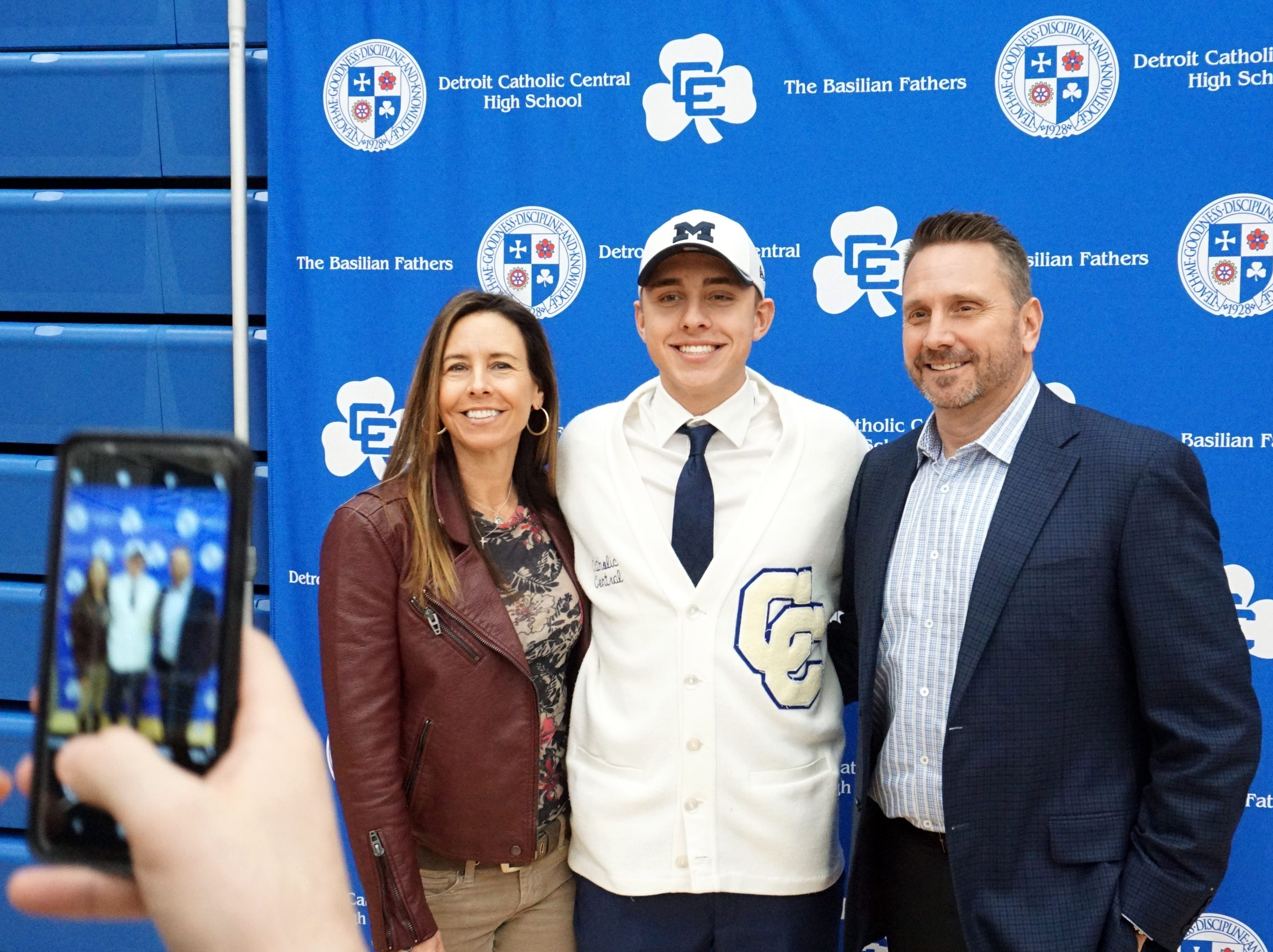 Owen Finnerty, off to play soccer at Univeristy of Michigan, poses for a photo with his parents Denise and Bryan on Feb. 7.