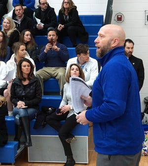 Detroit Catholic Central Athletics Director Aaron Babicz introduces the school's 25 scholar-athletes on Feb. 7 at the school's Signing Day ceremony. CC has students going to schools ranging from West Point, Brown, Hillsdale, Nebraska, MSU and UofM.