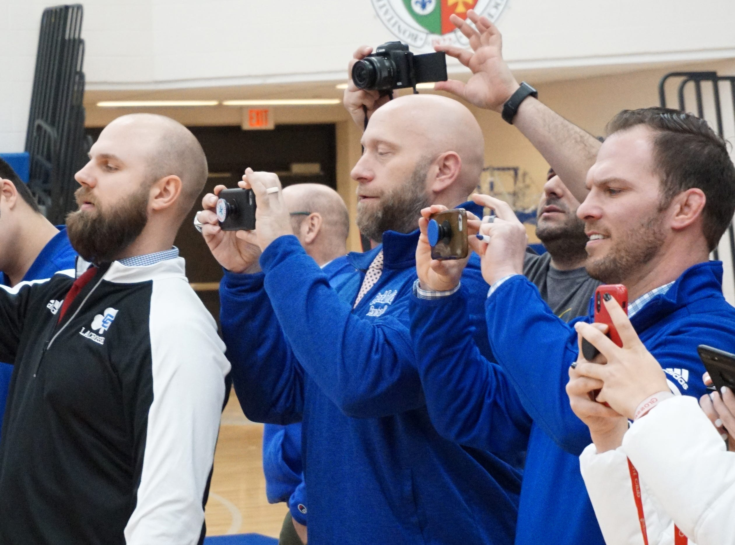 Detroit Cathlic Central staff and family take photos of their scholar-athletes on Feb. 7.