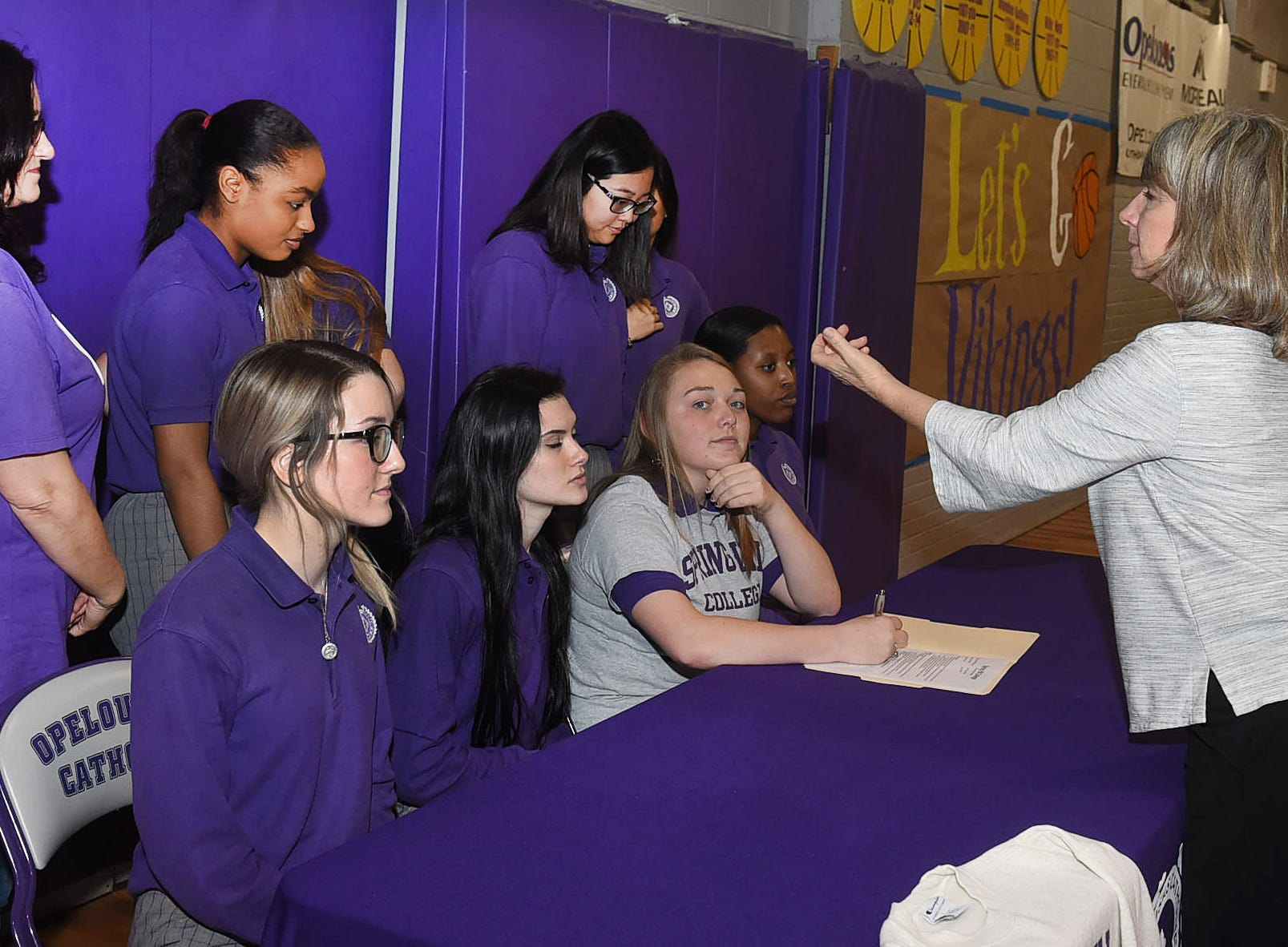 Madeleine Braham signs a letter of intent after receiving an athletic scholarship to Spring Hill College for her outstanding performances as a dancer with the Opelousas Catholic Vikettes.