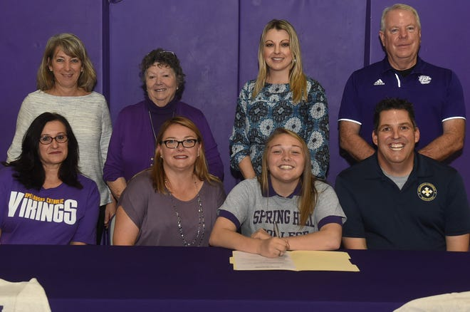 Madeleine Braham, flanked by her parents, John and Laura Braham, signs a letter of intent after receiving an athletic scholarship to Spring Hill College for being an outstanding member of the Opelousas Catholic dance team the Vikettes. Also pictured with Madeleine are her coach, JoAnn Briley, seated, and from left, Jill Artall, dance team coordinator, Principal Marty Heinz, Counselor Cindy LaFleur and Athletic Director Tommy Tate. The signing ceremony was held Thursday in the school gymnasium. See more photos at dailyworld.com and on the Daily World Facebook site.
