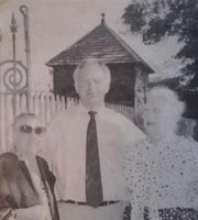 L-R: Preservationists Ruth Fontenot, Ed Dubuisson, and Celeste Stephenson pose in front of historic Prudhomme House in Opelousas.