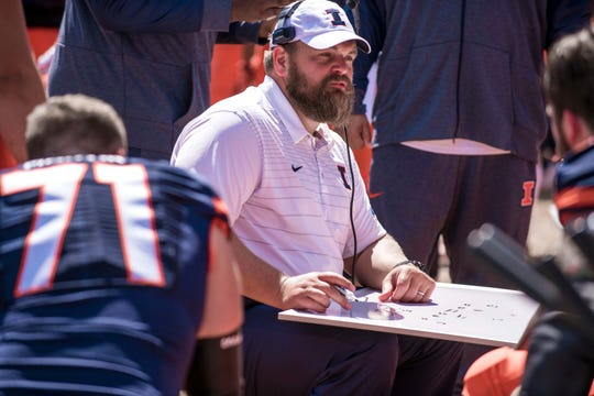 Illinois offensive line coach Luke Butkus talks to players during an NCAA college football game against Ball State Saturday, Sept. 2, 2017 at Memorial Stadium in Champaign, Ill. Illinois won 24-21. (AP Photo/Bradley Leeb)