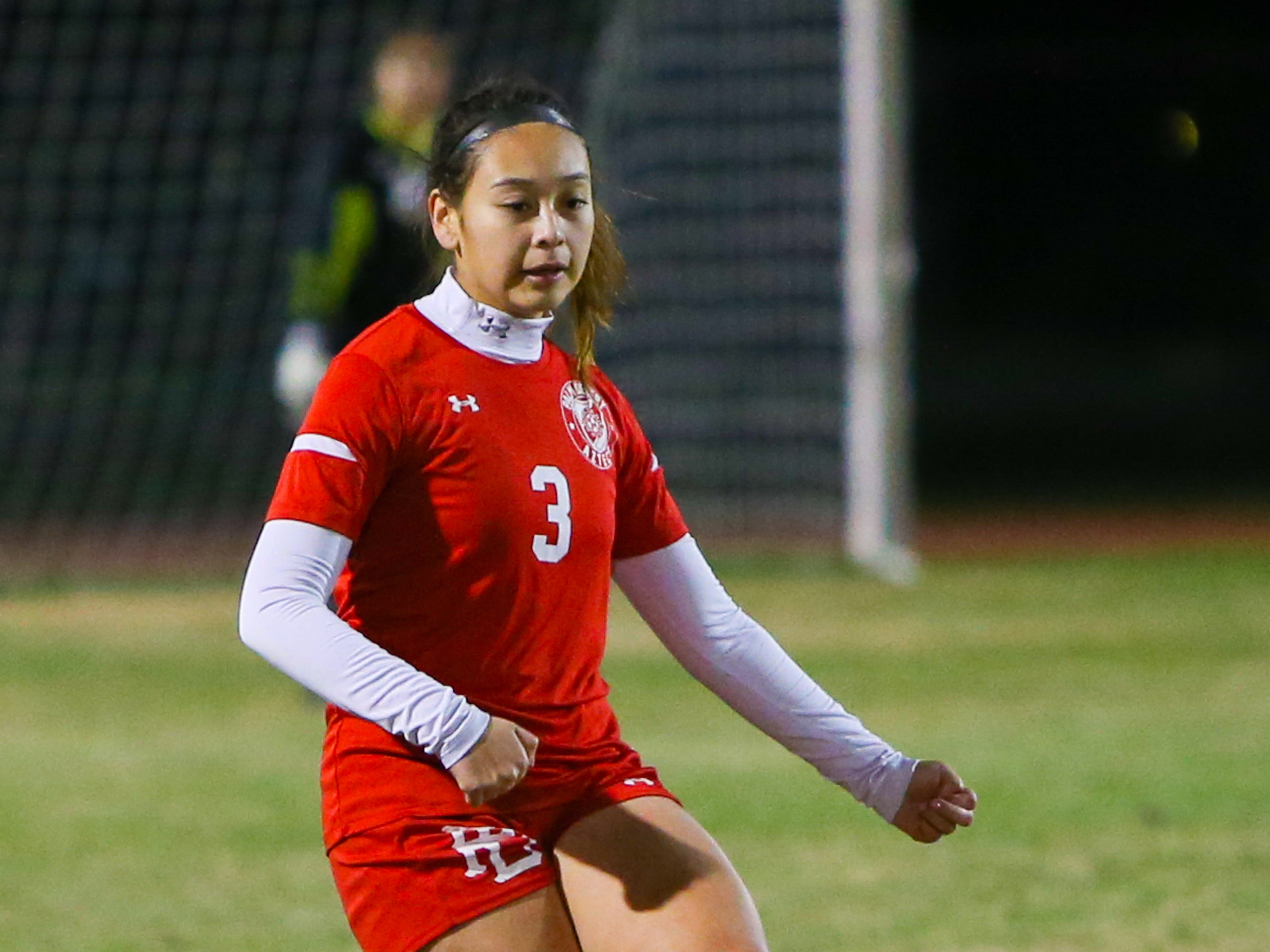 Andrea Soto passing the ball from downfield. The Palm Desert varsity soccer team won Wednesday's home playoff game against Miller by a score of 5-1.