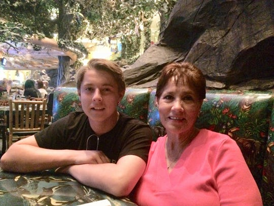 Jacob Montgomery, 19, left, was killed in a quadruple homicide in Palm Springs on Feb. 3, 2019. He one of three teens found dead in green Toyota Corolla in Palm Springs. He's show in an undated photo with his grandmother, Edie Carranza.