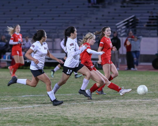 Kaitlin Clapinski scores one for Palm Desert. The Palm Desert varsity soccer team won Wednesday's home playoff game against Miller by a score of 5-1.