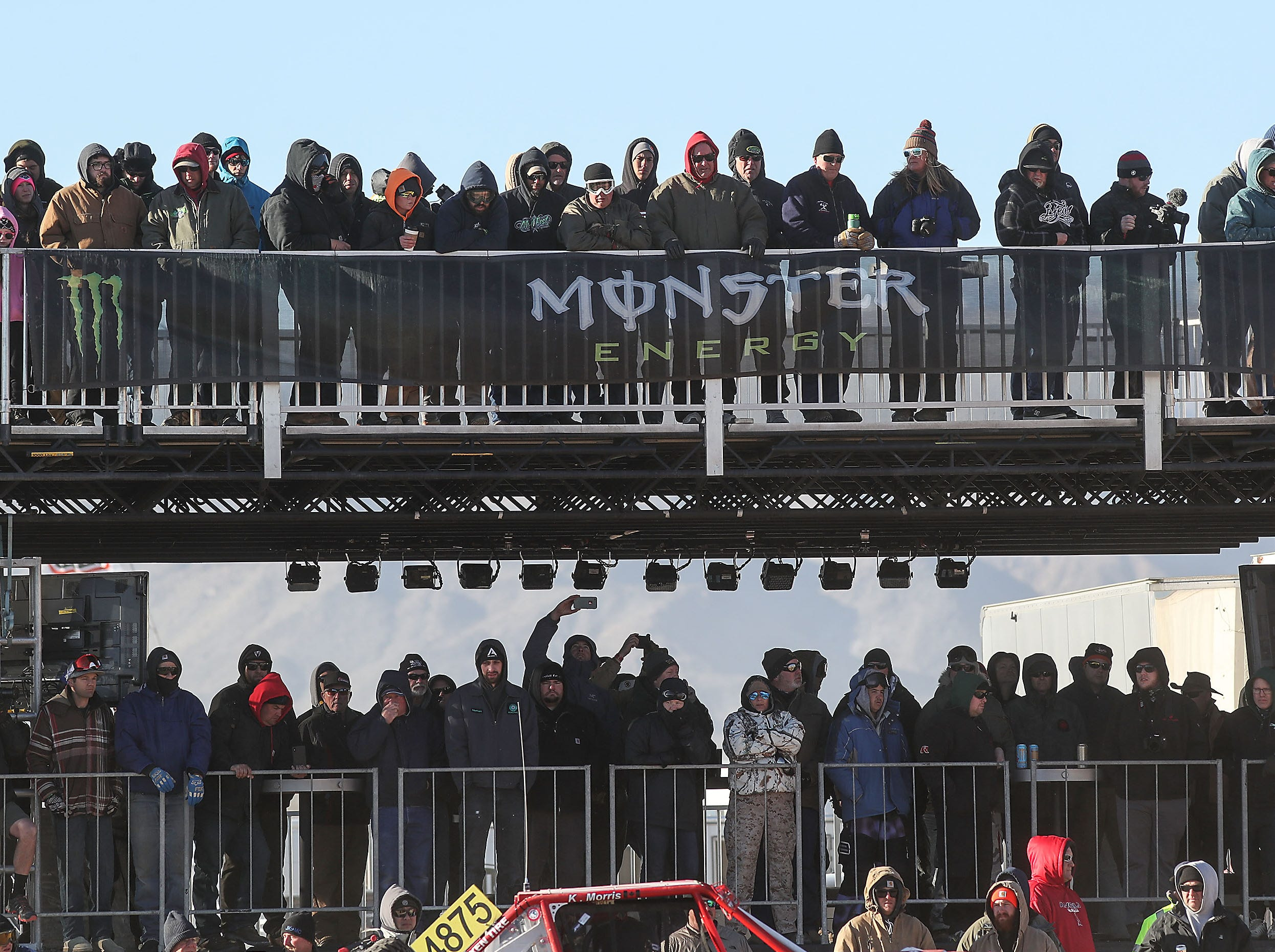 Fans watch competitors race in the King of the Hammers Every Man Challenge in Landers, February 6, 2019.