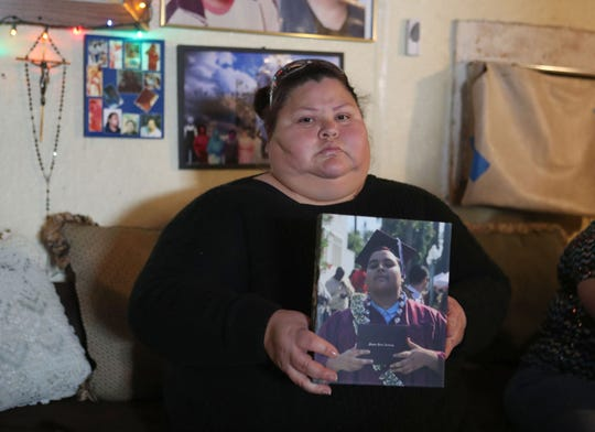 Juana Raya holds a photo of her son Juan who was one of four young people died earlier this week in Palm Springs, February 7, 2019.