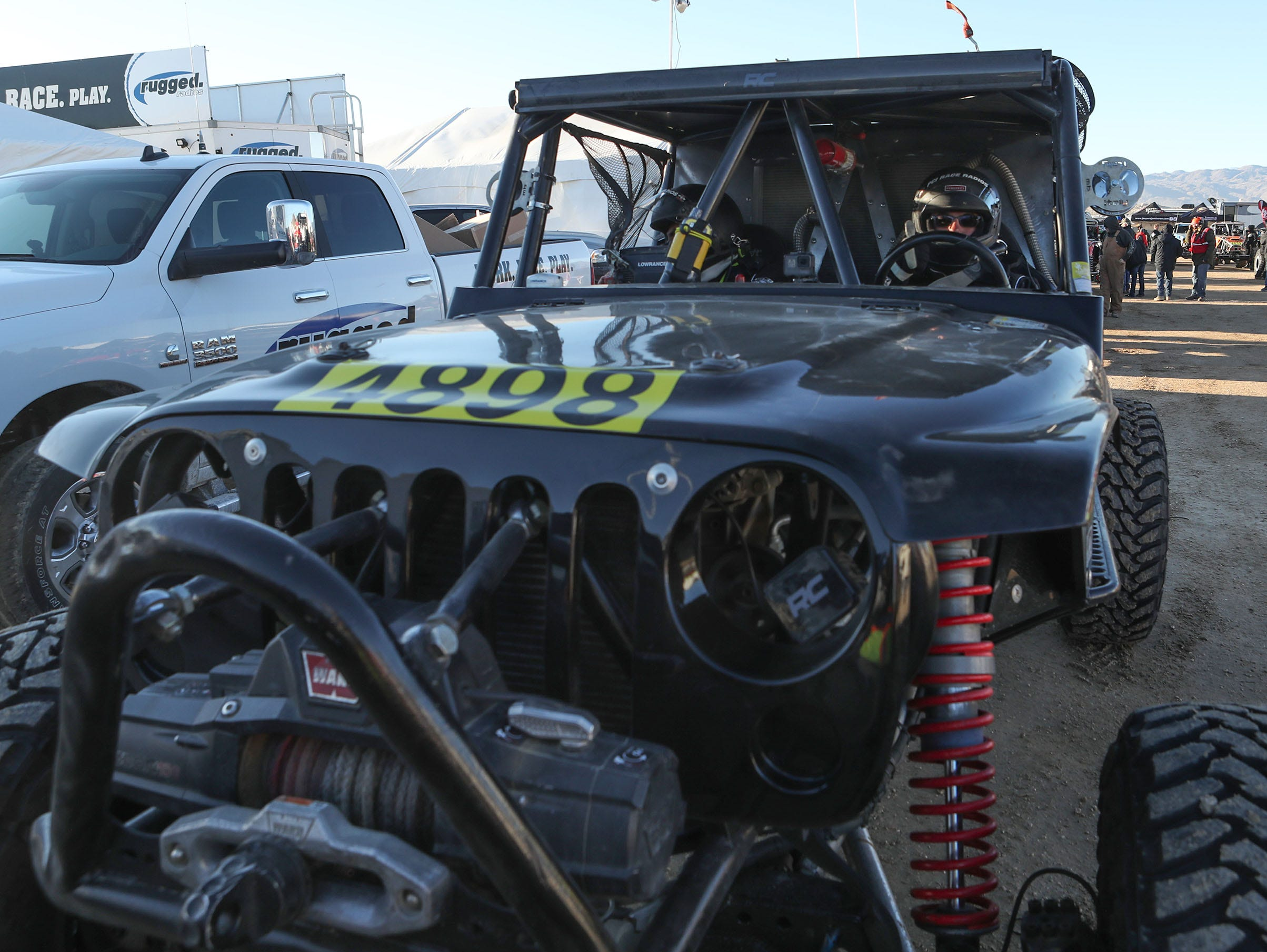 Indio mechanic Arturo Sora, right, and Vicente Farias get ready to race in the King of the Hammers Every Man Challenge race in Landers, February 6, 2019.